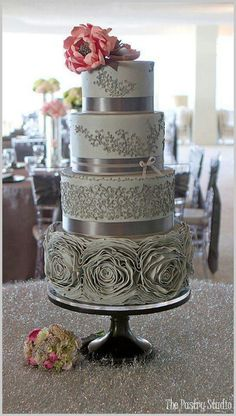 Grey wedding cake without the bottom roses and some more coral with it.