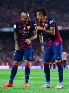 Neymar of FC Barcelona celebrates with his teammate Dani Alves after scoring his team's second goal during the Copa del Rey Final match between FC Barcelona and Athletic Club at Camp Nou on May 30, 2015 in Barcelona, Catalonia.
