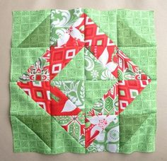 Christmas wreath block from Blossom Heart Quilts using half square triangles.