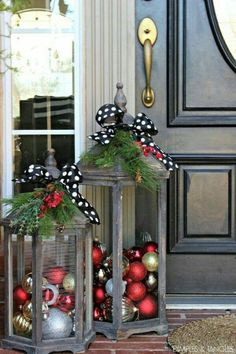 Give lanterns some love by filing them with shiny ornaments and adorning with a black and white polka-dot bow and some greenery – how very Kate Spade of you! #katespade #christmasdecor #christmasporches #christmas