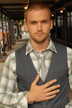 I love the vest with the tie and cowboy shirt... love the look!!!