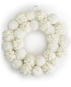Deck the halls this holiday season with the White Pom Pom wreath. This beautifully designed wreath is the perfect complement to your door or windows, adding to your festive decor. | Polyester | Wipe c