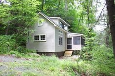 Brand New Complete Renovation. Enjoy your own private lakefront getaway in this cozy rustic cabin. Large 'Y' shaped dock with 100' of Lake Wallenpaupack frontage. Main level offer large enclosed porch over looking the lake and a bedroom with a lake view. The entire second floor loft is you 2nd sleeping area, also with lake views. Move In Ready!