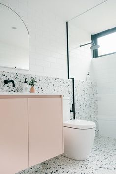 terrazo flooring Theres a lot to love in this Port Fairy project - from the practicality of the terrazzo tile half wall, millennial pink vanity for a pop Reece Bathroom, Laundry In Bathroom, Small Bathroom, Pink Bathroom Tiles, Light Bathroom, Modern Bathroom, Bathroom Ideas, Bad Inspiration, Bathroom Inspiration