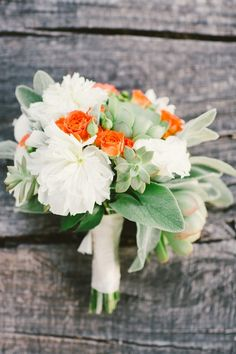 we love this white and orange bouquet with succulents in the mix http://www.weddingchicks.com/2014/02/07/santa-barbara-elopement-wedding-aga-jones-photography/