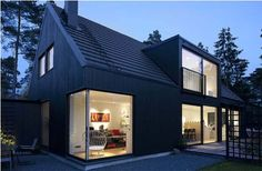 Love the squared gable on top of this modern Swedish house ...