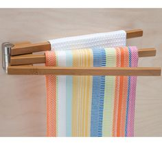 Always have a dry dishtowel at your fingertips and ready for use by storing them on a beautiful Bamboo Swing Arm Towel Bar.  This kitchen towel rack features three swiveling arms that provide convenient storage for your kitchen towels and dish rags and folds flat against the wall or cabinet when not in use.Handy Ba