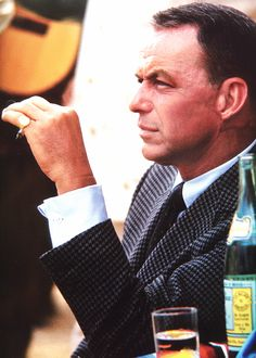 Frank Sinatra takes a break during filming of Marriage on the Rocks. Photographed by Bob Willoughby, 1965
