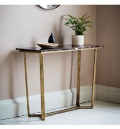 A contemporary console table featuring a rich brown Spanish Emperor marble top with distinctive yet subtle natural brown and white tones in the grain and a brushed bronze angled metal base. This neo classical style will suit a multitude of interiors. Brass Console Table, Modern Console Tables, Barrel Furniture, Table Furniture, Hallway Furniture, Black Marble, Marble Top, Gold Marble, Black Wood