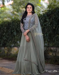 The silver undertones are what makes the tranquil shade saga green elegant. To this charm in saga green and cadet grey, an intermix of blue… Bride Reception Dresses, Wedding Reception Outfit, Wedding Dresses For Girls, Girls Dresses, Engagement Dress For Groom, Kerala Engagement Dress, Engagement Dresses, Lehenga Choli Wedding, Lehenga Gown