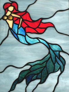Stained glass mermaid suncatcher panel is constructed using the Tiffany copper foil method. Each piece of glass has been hand cut, foiled,