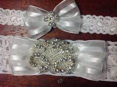 Heirloom garter set shadow stripped ribbon bow with rhinestone appliqué set in middle, for the bride that loves to sparkle! on Etsy, $65.00