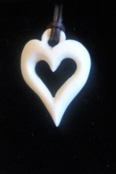hand carved love heart pendant  www.carlimakesthingsoutofbone.webs.com
