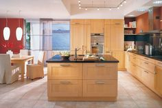 island kitchen 30 Kitchen Islands Designs Adding a Modern Touch to Your Home --Interesting use of wide and narrow doors next to stove, could break up even-sized pattern of cabinets...