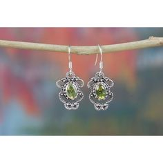 Charming Sterling Silver And Peridot Earrings via Polyvore featuring jewelry, earrings, earrings jewellery, sterling silver jewellery, charm jewelry, peridot jewelry and peridot earrings