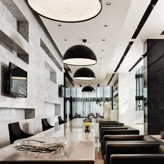 Gorgeous modern, black and white dining/conference room. Skygarden light fixtures.
