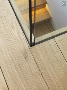 butterfly joint in floorboards, glass partition
