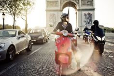 """Scooter group ride on the Champs Elysees with the Arc de Triomphe in the background. I think I am going to write a movie script called """"A Vespa in Paris. Scooter Girl, Vespa Girl, Scooters Vespa, Vespa Lambretta, Scooter Motorcycle, Tour Eiffel, Oh Paris, Bicycles, Vespas"""