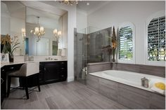 Floor and shower cabinet are nice, but it's too much to put the same tiling also around the bath. The bath itself is also not very nice