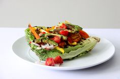 Grilled Romaine and Pepper Salad is a grilled romaine salad topped with grilled peppers, shallots or onions, and avocado!