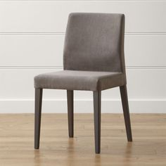 Shop Monterey Charcoal Dining Chair.   Charcoal-stained solid ash legs add to the chair's clean-looking statement.   The Monterey Charcoal Dining Chair is a Crate and Barrel Exclusive.
