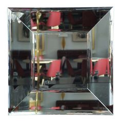 Stunning mirror made in Italy and designed by Roberto Giulio Rida in 1990. The outer and inner mirrored frame are beveled with mirroring on the sides, a remarkably beautiful piece.