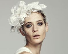 Jennifer Behr - A couture blooming lace headpiece.