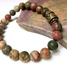 Gorgeous natural red creek jasper with antiqued brass.  ________ •Choice of 2 styles •Stretch bracelet for men & women; a great couple's set •Custom-sized for you •Gift-ready packaging