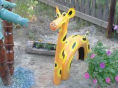 Plastic pipe and car tyre giraffe