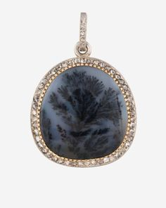 A CARTIER DIAMOND MOSS DENDRITIC AGATE PLATINUM PENDANT, NUMBER 9862, LONDON, EARLY 20TH CENTURY. Of oval form, the cabochon agate within a border of rose-cut diamonds. Shapiro Auctions