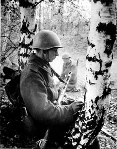 The young Soviet soldier is writing a letter in between fights.