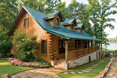 The cabin's traditional outside appearance disguises the wide open spaces within. The porch wraps around three sides of the lakefront home and leads to cascading decks.