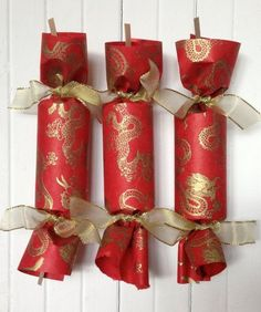 Celebrate with the Dragon Party Cracker is wrapped in handmade paper from Nepal and tied with gold wired ribbon. The highlight of every occision Chinese Theme Parties, Chinese New Year Party, Chinese New Year Crafts, Happy Chinese New Year, New Years Party, Chinese Dinner, Chinese Door, Asian Party Decorations, Chinese New Year Decorations