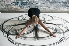 "In her series ""Emptied Gestures,"" artist and dancer Heather Hansen uses her entire body to create large-scale geometric charcoal drawings in works that are part drawing and part perform…"