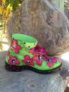 Funky junky painted work boot...love the little flower pot inside for planting
