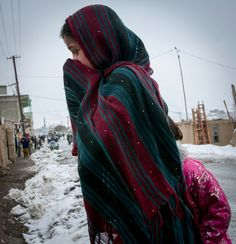 Young girl crossing a street in Gardez. At first glance you see snowflakes falling - but it's the pattern on her shawl. It was very cold that day - but all the kids flocked to us as we rolled through town. The girls, as always, were very shy.