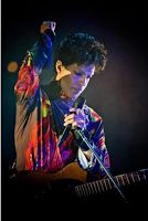 Prince and his guitar...mmm from>>  All About Prince: UK Singer Delilah Talks Prince