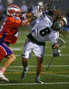 Hamilton Nationals midfielder Dan Burns, left, checks Long Island Lizards midfielder Brian Langtry during their Major League Lacrosse game in Hamilton, Ontario. Burns and the Nationals ended the season on a high note, winning 18-8.