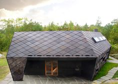 Slate shingles create a crisscrossing pattern across the outer walls of this cabin in Norway
