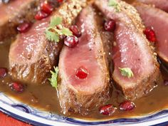 Roasted Lamb with Pomegranate-Tamarind Sauce from FoodNetwork.com