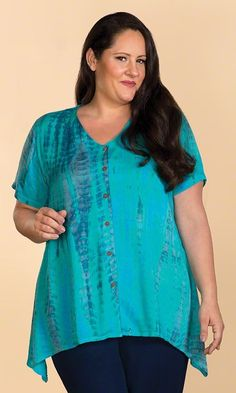 Accentuated by flattering turquoise and blue hues, our Aqua Tie Dye Blouse is brought to life!      Shown with our  Tailored Rayon Pants      Art you can wear!     Gently curved hem    Soft woven fabric      Short sleeves     100% rayon     33 long in size 4X     Machine wash     Imported