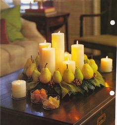 Fruit and candles centerpiece.