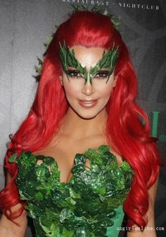 Kim Kardashian dressed as Batman villain Poison Ivy. This I may use for an easy custom masquerade type mask, looks like felt, double sided  breast tape, and glitter glue might work.