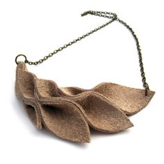 How to make a Leather Leaves Necklace.  I think thick felt might work as well.