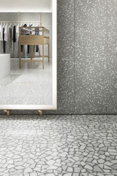 David Chipperfield Architects – Valentino Man Store - Terrazzo floor and wall cladding. The same stones and aggregates appear to have been used its just the composition that is different - larger pieces of stone on the floor