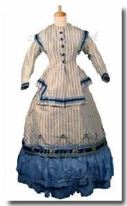 Late 1860s day dress with interesting details via flickr.