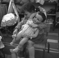 girl with huge French celluloid doll
