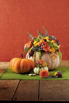 Feel free to take a more natural approach with your pumpkin decorating and skip the spiderwebs and jack-o-lanterns. Simply carve a hole in a pumpkin and fill up with your favorite fall blooms.