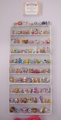 Storage for Littlest Pet Shop - silverware trays painted white and hung on the wall.