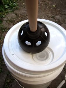 Hillbilly washing mashine Plunger with holes cut & 5 gal bucket. This would actually work pretty well if ever needed.